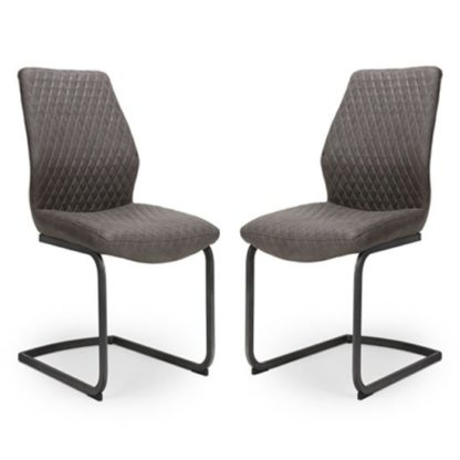 An Image of Charlie Grey Faux Leather Dining Chairs In A Pair