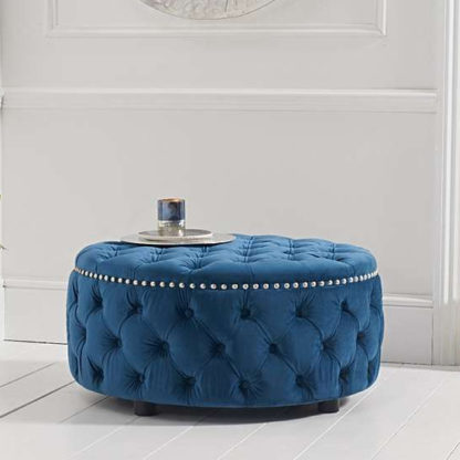 An Image of Aniara Velvet Round Footstool In Blue