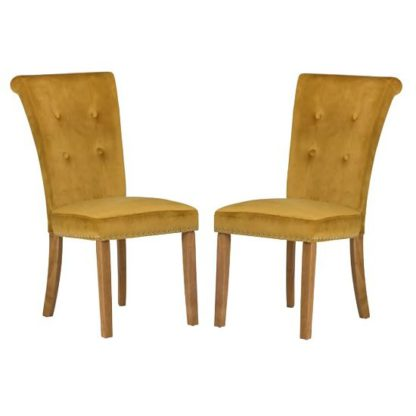 An Image of Wodan Velvet Dining Chair In Mustard With Oak Legs In A Pair
