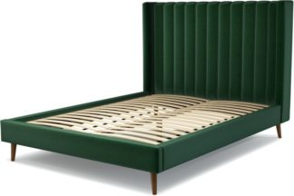 An Image of Custom MADE Cory King size Bed, Bottle Green Velvet with Walnut Stained Oak Legs