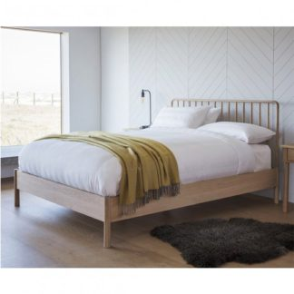 An Image of Wycombe Spindle Double Bed In Oak