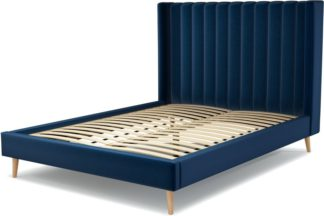 An Image of Custom MADE Cory King size Bed, Regal Blue Velvet with Oak Legs