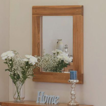 An Image of Velum Wall Bedroom Mirror In Chunky Solid Oak Frame