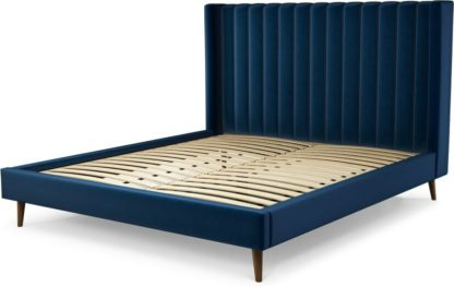 An Image of Custom MADE Cory Super King size Bed, Regal Blue Velvet with Walnut Stained Oak Legs