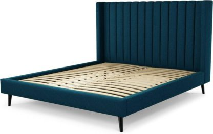 An Image of Custom MADE Cory Super King size Bed, Navy Wool with Black Stained Oak Legs