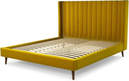 An Image of Custom MADE Cory Super King size Bed, Saffron Yellow Velvet with Walnut Stained Oak Legs