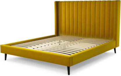 An Image of Custom MADE Cory Super King size Bed, Saffron Yellow Velvet with Black Stained Oak Legs