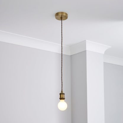 An Image of Charlie Industrial Flex Fitting Antique Brass