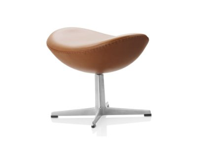 An Image of Fritz Hansen Egg Footstool Grace Leather Walnut