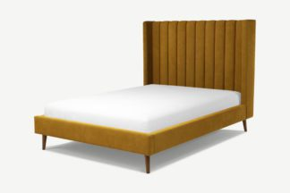 An Image of Custom MADE Cory Double Bed, Dijon Yellow Cotton Velvet with Walnut Stained Oak Legs