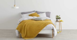 An Image of Grove 100% Cotton Stonewashed Waffle Bedspread,150 x 200cm, Mustard