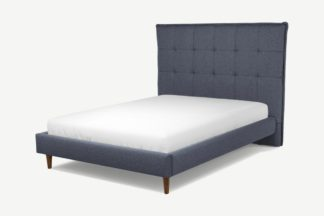 An Image of Custom MADE Lamas Double Bed, Navy Wool with Walnut Stained Oak Legs