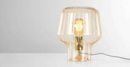 An Image of Ewer Table Lamp, Champagne Glass and Polished Brass