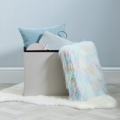 An Image of Pastel Faux Fur Foldable Cube Ottoman Pink
