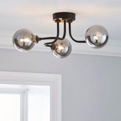 An Image of Tanner 3 Light Black Ceiling Fitting Black