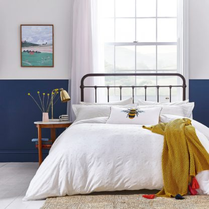 An Image of Joules Botanical Bee Knit Throw Gold