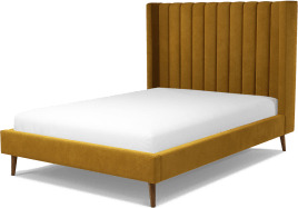 An Image of Cory Double Bed, Dijon Yellow Cotton Velvet with Walnut Stained Oak Legs