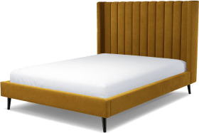 An Image of Cory King Size Bed, Dijon Yellow Cotton Velvet with Black Stained Oak Legs
