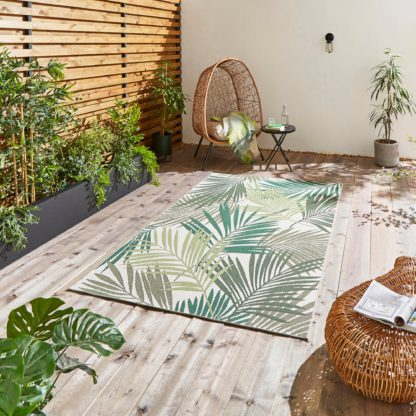 An Image of Miami Leaf Print Indoor Outdoor Rug Dark Green