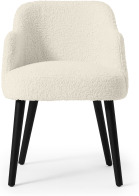 An Image of Swinton Carver Dining Chair, Faux Sheepskin with Black Legs